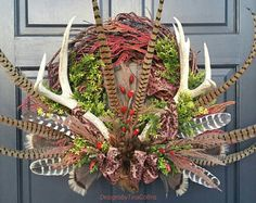 Check out our christmas door wreaths selection for the very best in unique or custom, handmade pieces from our shops. Christmas Door Wreaths, Fall Wreaths, Christmas Crafts, Christmas Decorations, Christmas Ornaments, Xmas, Hunting Wreath, Antler Wreath, Feather Wreath