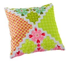 Use large rickrack and prints to create a square patchwork pillow.