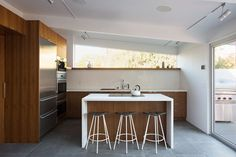 Walnut/white kitchen - eat in island... two-foot square Nextra Piombo tiles by Monocibec