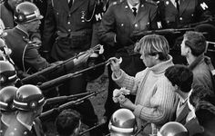 Flower power: photo taken by photographer Bernie Boston during protests against the Vietnam war.