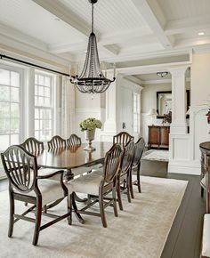 A simple dining room with floor to ceiling windows. Bellevue, WA Coldwell Banker BAIN