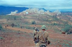 Description of Air Cavalry troops taking part in Operation Pegasus are shown walking around and watching bombing on a far hill line on April 1968 at Special Forces Camp at Lang Vei in Vietnam. Vietnam History, Vietnam War Photos, American War, American History, American Veterans, My War, North Vietnam, Vietnam Veterans, Military History