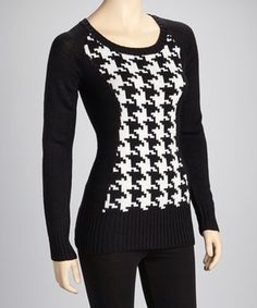 Cozy meets chic in this on-trend sweater with a houndstooth pattern that adds extra flair to its fierce figure-hugging silhouette.
