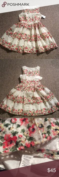 """NWT Everleigh dress, size S Gorgeous dress by Everleigh in a full skirted translucent gingham floral dress that was once sold by Anthropologie? Mine was purchased at Nordstrom rack and still has the tag on. The dress has an invisible side zip, full lining and beautiful textured fabric. It's perfect to twirl in! Waist is about 14"""", bust 17.5"""" and length is about 34"""". Anthropologie Dresses"""