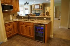 Basement Kitchen cabinet - Homecrest cabinets, Heritage, Rustic Hickory Light, Silver Cream Granite, Kitchen by Kitchen Sales Gallery showroom location, Knoxville TN