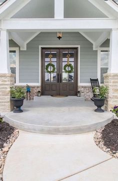 Front porch. Stained front doors. Double front door. Farmhouse design. Photo credit: Christina Woods