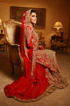 I love the simplicity yet intricacy of the dress plus that shade of red is gorgeous!