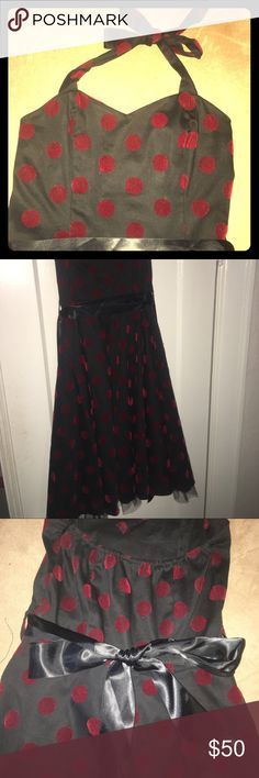 Vintage pinup boutique midi dress Brand new- never worn. Bought it at a boutique in New Orleans. Black with velvet pokadots and silk ribbon belt and sweetheart neckline/ halter. Flares out. Soooo flattering and sexy/fun. Would fit 4-6 Boutique  Dresses Midi