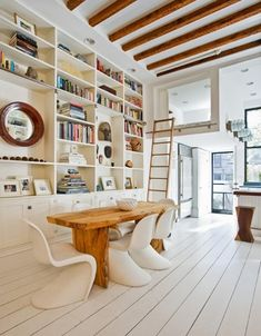 love the all white and natural wood