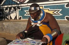 Ndebele woman painting, Botshabelo Ndebele village, South Africa