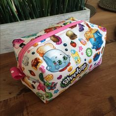 Shopkins zipper pouch 🔴FIRM🔴 Adorable Shopkins zipper pouch made to order!! Great for carrying those adorable shopkins or great for makeup or as a traveling pouch 🤗💗🍭 Bags Cosmetic Bags & Cases