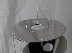 These wind chimes are built strong with All Metal (Aluminum Alloy) Platters, 7 strand beading wire (strong), and All metal crimps, loops, and clasps. They have a middle to Higher Pitch Metal Sound. These are really reflective and create prisms ALL over the House and Sound good doing it. These are lightweight and easy to hang. Some may contain hardly visible imperfections. We try to use only the perfect platters, but sometimes there may be hairline imperfections. You will receive 1 windchime…