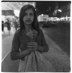 Child Selling Plastic Orchids at Night, New York City 1963 by Diane Arbus - Google Search