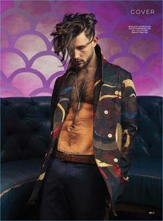 Appearing in a Gay Times photo shoot, Nico Tortorella wears a Palmiers du Mal coat with Tommy Hilfiger trousers.