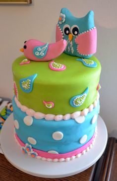 Owl and Lovebird Baby Shower - Baby shower cake designed to match the baby bedding (My Baby Sam Pixie Aqua). The owl was from the invitation. Fondant with gum paste toppers, royal icing details and buttercream borders. Coordinating cookies posted in cookie community album.
