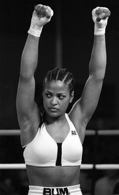 F 358563 005 Verona,New York Laila Ali, Daughter Of Muhammad Ali Celebrates Her Win Over April Fowler. The Turning Stone Casino Hosted The Fight That Ali Won In A Ko. Karate, Female Boxers, Boxing Girl, Women Boxing, Boxing Boxing, Leila, Poses References, Muhammad Ali, Black Girls Rock