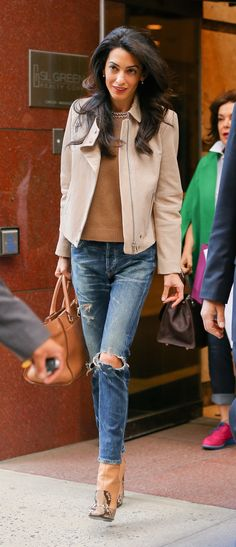 The barrister proves that ripped jeans can be polished with the addition of a structured jacket and heels.