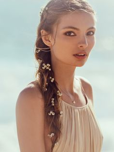 Babys Breath Braid In | Run these delicate tiny flowers through your strands to add a subtle pop in your locks. Suede cord and metal bead accents. Clips easily into hair. *By Free People