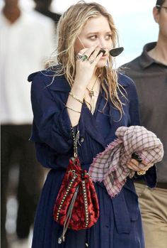 a navy blue trenchcoat....Mary Kate Olsen