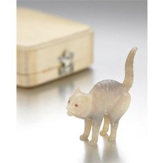 A FABERGÉ CARVED FIGURE MODEL OF A CAT, CIRCA 1900 realistically modelled in a defensive stance, the eyes set with rubies, in a fitted Fabergé case