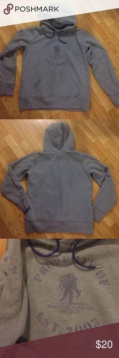 WWP Under Armour Hhodie Under Armour Wounded Warrior Project  Hooded Sweatshirt. Size Medium. Gray with purple woman's hoodie. Well worn and faded but lots of wear left on it.  Some piling. The purple lettering was faded look when purchased but it's faded more. Great Hoodie!!  Any questions please ask. Thank You 😊 Under Armour Tops Sweatshirts & Hoodies