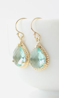 We just can't get enough of the aqua-yellow gold combo! We are in love with these drop earrings! https://www.facebook.com/pages/Chris-Alix-Custom-Jewelry/187194701308962