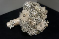 Broach wedding bouquet: something borrowed- have important women in your life lend you old broaches to make a unique sentimental bouquet! Cute idea I think