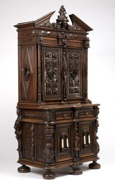 A19th century, Renaissance Revival Walnut Cabinet-on-Cabinet..
