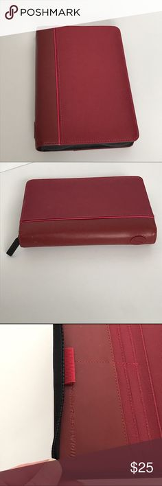 Filofax stretch zip personal organizer burgundy NWOT. Never used, has sat on shelf. Has 4 tan marks along spine. Tight rings. Has all it's original inserts- calendar from 2010, to do lists, contact pages,  personal expense pages, colored line pages, fold out world map, and plastic business card holder pages. Has 2 pen holders and has slots on front inside cover. Zips all way around. Spine in leather like material, most of front and half of back is cover in nylon material Filofax Accessories