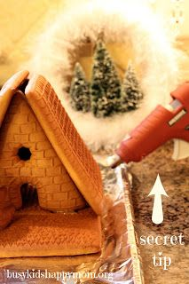A glue gun is the secret trick to putting together a gingerbread house.