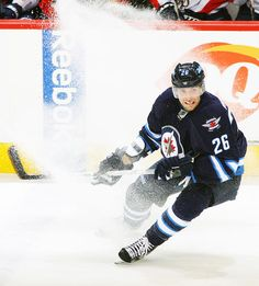 Florida Panthers at Winnipeg Jets Game W 7-2- 04/11/2013 Blake Wheeler #26 of  Winnipeg sends up a shower of snow as he follows the play up the ice during first period action against the Florida Panthers at MTS Centre.  (Photo by Jonathan Kozub/NHLI via Getty Images)