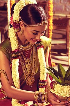South Indian bride. Temple jewelry. Jhumkis.Silk kanchipuram sari.Braid with fresh flowers. Tamil bride. Telugu bride. Kannada bride. Hindu bride. Malayalee bride. Amy Jackson for Tanishq.