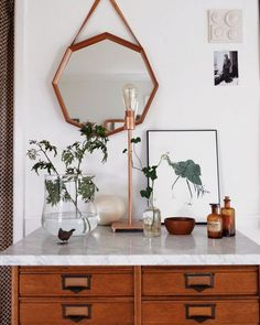 Rose gold mirror & apothecary table