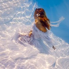 """Four years ago, I told you about the project """"Alice In Waterland"""" by photographer Elena Kalis, featuring her young daughter Sacha Kalis, aka Bahamas Girl. Under The Water, Under The Sea, Underwater Pictures, Underwater Photos, Underwater Photography, Underwater Wedding, Fantasy Photography, Photography Women, White Photography"""