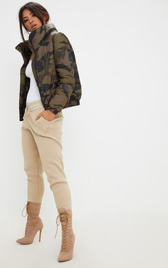 Camouflage Puffer JacketWrap up in style girl with this hella lit puffer jacket. In a cropped fit...