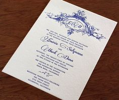 classic floral framed monogram on beautiful blue letterpress wedding invitation by invitations by ajalon