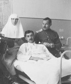 Sister of Mercy Olga Romanov with her patient Dmitri Shakh-Bagov (Mitya) (in bed) and another officer.
