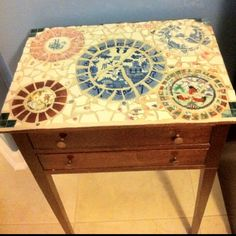 Antique table found at Goodwill-I just broke some plates and made a pretty mosaic top.