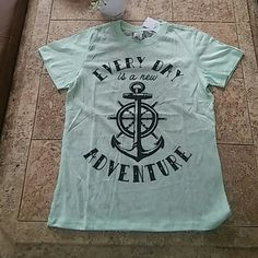 Lace Tshirt Everyday is a new adventure. Mint tee with a full lace back. SO CUTE. Freeze Tops