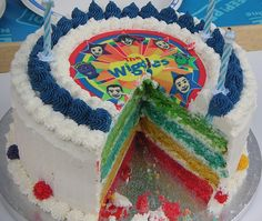 Wiggles cake @Hannah Mestel Mestel Mestel Duarte this is a cute idea simpler on the outside and colorful on the inside I know how to make these kind :) I'll do it!
