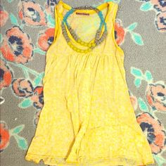 Anthorpologie Tank Worn only once!! Great lightweight Anthropologie tank top! Empire waist detail and longer length (length is below hip bone.) 50% Cotton & 50% Polyester. **Paired with an Anthropologie necklace also listed on Posh Mark in a separate listing. Let me know if you'd like me to bundle them!!  Anthropologie Tops Tank Tops
