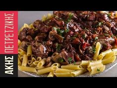 Coq au vin by Greek chef Akis Petretzikis. A super delicious French dish made with wine braised chicken. tomatoes, bacon, mushrooms, aromatics and penne pasta. Penne Pasta, Pasta Noodles, French Dishes, Braised Chicken, Chicken Recipes, Bacon, Stuffed Mushrooms, Healthy Recipes, Healthy Foods