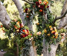Trees dripping in bright and beautiful garlands lined the path to this afternoon celebration. Click to view the exclusive look: