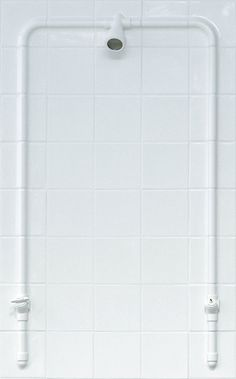 There are pipes behind these tiles.... ingenious.   Also available in white
