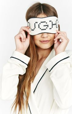 UGH, just 5 more minutes! This deliciously soft eye mask is the perfect piece to put you to sleep. Featuring light padding across the eyes, an elastic band, and contrast piping. Backed with black fabric so you can snooze anytime you want. Constructed from a modal/spandex blend. In Pearl.  89% Modal 11%Spandex