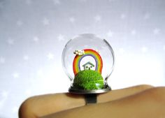 Terrarium ring with a tiny house and a rainbow - Spring ring. HoKiou via Etsy.