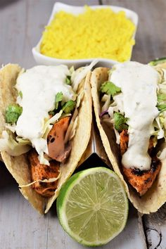 blackened salmon tacos with lime in front