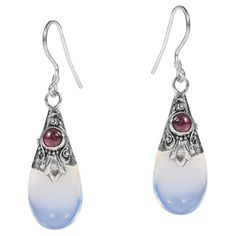 K'Jai handcrafted this sterling silver earring set. This set features a teardrop Moonstone centerpiece on sterling silver. A unique and vibrant des...