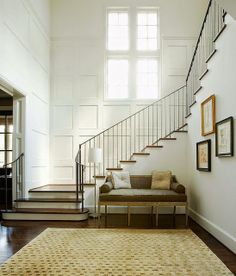 like the boxed pillows on the settee, open foyer, lovely staircase . Longmont - traditional - staircase - houston - Thompson Custom Homes Benjamin Moore Cloud White, Wainscoting Stairs, Wainscoting Height, Wainscoting Nursery, Painted Wainscoting, Wainscoting Ideas, Entry Stairs, Grand Staircase, Stairway Walls