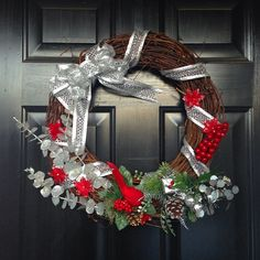 Still so in love with this #christmaswreath I made 2yrs ago! #christmasdecorations #wreath #doordecor #homemade #poinsettias #cardinal #dearborndrive #etsy #etsyshop #etsyelite #charlotte #nc #queencity #bigbow